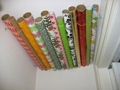 omg.. brilliant.. store wrapping paper in the ceiling of your closet with just a few tacks and a couple pieces of string..!