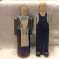 Wolf Creek folk art carvings couple signed by artist Betty Hines.