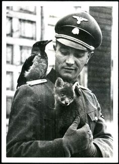 SS Officer with forest friends.Contrasting elements, one might say.