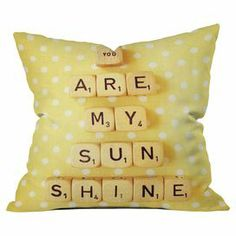"""Woven pillow with a typographic tile motif by artist Happee Monkey for DENY Designs. Made in the USA.   Product: PillowConstruction Material: PolyesterColor: YellowFeatures:  Designed by Happee Monkee for DENY DesignsInsert included Dimensions: 20"""" x 20"""""""