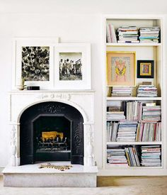 ornate fireplace with art and built-in bookshelves. / sfgirlbybay