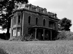 This house reminds me of Miss Havisham. You can tell it was beautiful once but decay has taken over. Mudhouse Mansion in Lancaster, OH by thebobblog, via Flickr