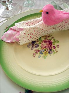 Table setting for the summer: polka-dots, a pink bird and a vintage rose setting.