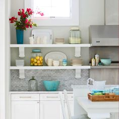 Open shelves on either side of the range..... Having dishes in view makes it easy for guests to help out with food prep and find dishes to serve themselves.