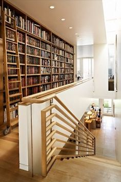This is a crazy website - Bookshelf Porn!  Check it out - many ideas for storing & displaying your books!