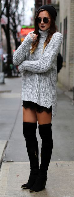Tall black boots + grey chunky knit.