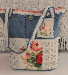 old denim pants and home decorator samples were the base for this bag. I used Blooming bias to finish edges and add detail.