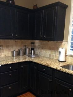 Love the black cabinets but would have a white back splash and a lighter color granite. Painting Thermofoil Cabinets with Annie Sloan the Reveal - Farm Fresh Vintage Finds Farmhouse Kitchen Cabinets, Kitchen Cabinet Design, Painting Kitchen Cabinets, Kitchen Paint, Kitchen Backsplash, Diy Kitchen, Kitchen Decor, Backsplash Design, Backsplash Ideas