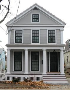 Taupe, putty color with white/cream trim.  With inside trim and grills painted black.  From;  An Urban Cottage