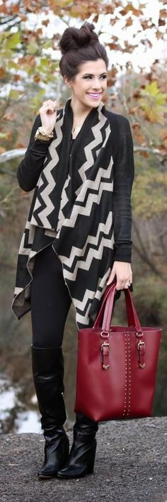 Shop this look on Lookastic:  https://lookastic.com/women/looks/open-cardigan-leggings-knee-high-boots-tote-bag-bracelet-watch/8758  — Gold Bracelet  — Gold Watch  — Black Leggings  — Black Leather Knee High Boots  — Burgundy Leather Tote Bag  — Black Chevron Open Cardigan