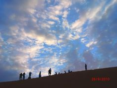 Watching sunrise in the Sahara Desert  Taken by Naomi Redel during a 10 # Travel # to Morocco
