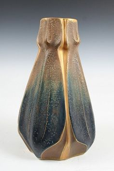 Ernst Wahliss Art-Nouveau-style vase with a naturalistic shape as if formed from leaves. Decorated with purple iridescent glaze and hand painted with applied gilding, ca.1892-1910; marked
