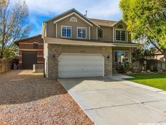 """*Fresh Paint*Stunning 2-Story w/32X40 Cinder Block Workshop! Gourmet Kitchen w/Island-Granite Counters, Sub Zero Fridge, 48"""" GE Monogram 6 burner Gas Range w/Griddle, GE Profile Micro w/Advantium Technology & Beautiful Cherry Cabinetry. The French doors take you out to the patio & beautiful yard, great for entertaining. The front room can be used as a living room, professional s office or a piano room. The master bath has recently been finished w/upscale vanity w/granite counter, sep"""