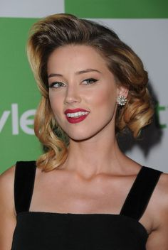 Hair Lookbook: Amber Heard wearing Medium Curls (9 of 11). Amber Heard showed off a more lady like style while attending the InStyle event. She topped her look off with a retro 'do.
