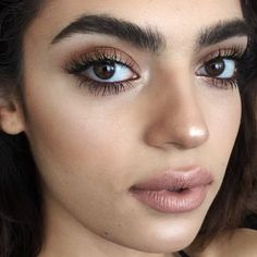 Metallic eye shadow with thick, ungroomed brows and lush lashes