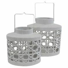 Set of 2 ceramic candle lanterns with openwork designs.