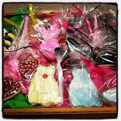Lots of fun cookies for sale in the shoppe today! Be sure you order EARLY for Valentines Day!  336-261-8725 April@mainstreetcakeshoppe.com Princess dresses, bees, heels, hearts!