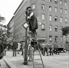 Germany Berlin (West) Wedding - West-Berlin people watching the escape of Frieda Schulze, who escaping out of the window of her flat in East-Berlin to West-Berlin. Bernauer Strasse — September 25, 1961