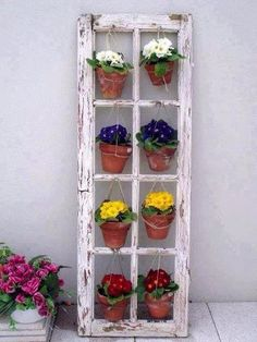 hang pots (flowers or herbs) in old window frame (glass removed)