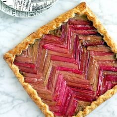 Honey rhubarb galette features tangy fruit atop flaky pastry with a creamy, nutty filling in between.