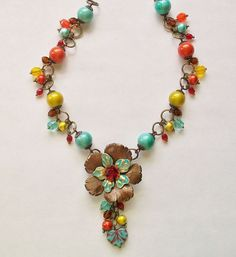Summer Colors/Choxie Challenge from Novegatti Designs:  Chocolate brass and handpainted brass flower (from B'Sue's), with a colorful assortment of glass spectra and Czech faceted glass beads.   www.facebook.com/NovegattiDesigns