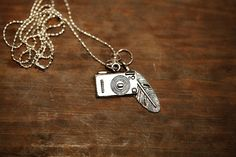 cute little camera feather necklace