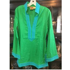 Tory Burch Classic Cotton Tunic Sz 6 Tory Burch Classic Cotton Tunic Sz 6. Green/Turquoise trim. Smoke free home. EUC. No rips, no stains, dry cleaned and has been hanging in closet. Fabric is semi-sheer, very light, very comfortable. *last photo shows color more accurately. Tory Burch Tops Tunics