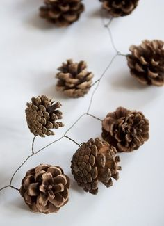 "spray paint the cones first and add glitter while its drying. then you have pretty ""frosted"" looking pine cones to use for the garland! Noel Christmas, Winter Christmas, All Things Christmas, Xmas, Christmas Ornaments, Pine Cone Christmas Decorations, Christmas Candles, Natal Natural, Navidad Diy"
