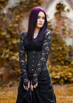 Goth girl with beautiful lace sleeves and purple ombré hair.
