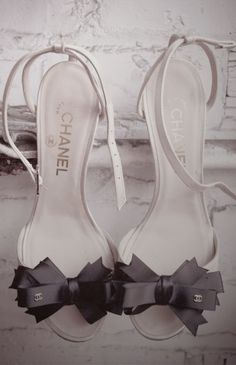 This gorgeous pair of Chanel bow heels almost depicts the personality of Coco Chanel, pioneering French fashion designer herself; whose modernist thought, menswear-inspired fashions, and pursuit of expensive simplicity made her an important figure in 20th-century fashion. These are the perfect heels for a black and white themed wedding.