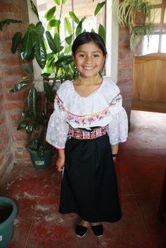 native american girl the traditional dress in Otavalo Ecuador
