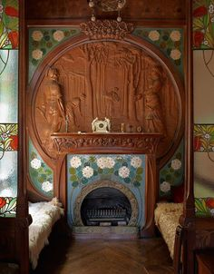 "indigodreams: ""House-museum of the Casa Navas in Catalonia Furniture for the home in the 1900s was designed by Gaspar Omar. Fireplace tiled and surrounded by a wooden carving. Benches covered with sheepskin. """
