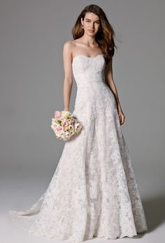 Watters. This strapless, A-Line gown of heritage lace with a sweetheart neckline and lace-covered buttons down the back gives a beautiful, traditional look to any bride. Sweep Train. Shown with Mareen belt 8903B (sold separately).