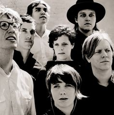 Arcade Fire  I'm not familiar with them but it's a nice photo of them!