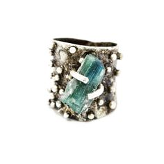 Art Jewelry:  Concave and distressed Sterling silver ring, set with silver granules and blue green Tourmaline
