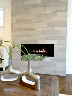 Inside Innovation Summit with Cambria Home Tour - Tile Plank Modern Fireplace Modern Fireplace Tiles, Tiled Fireplace Wall, Tv Above Fireplace, Fireplace Tile Surround, Home Fireplace, Fireplace Remodel, Fireplace Surrounds, Fireplace Design, Fireplace Ideas