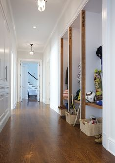 Amazing kids' mudroom design with built-in nooks filled accented with long rulers and baskets tucked under built-in benches. Entry Closet, Home Decoracion, Dream House Interior, House With Porch, House Rooms, Beautiful Interiors, White Walls, Laundry Room, Furniture