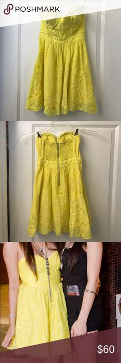Bebe Strapless Yellow Sundress Bright yellow strapless sundress with inner lining in the skirt area. Chest area is structured for built in support and lightly padded to use without a bra. Back has stretch material and bodice material that flattens out any unwanted areas for a nice silhouette. bebe Dresses Strapless