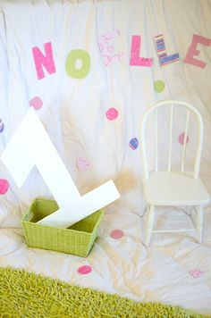 Made the absolute cutest 1st Birthday Backdrop this morning, using: an all white down comforter, some scrapbooking paper, tape, and a homemade wooden one the hubby cut out that I painted all white :)) Can't wait to get to shooting the cute Birthday girl!!