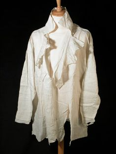 Mans shirt - White linen, high collar turned over with frill around front opening. Full sleeves finely gathered. 1820 - 1830