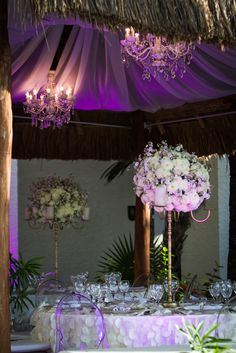 Tall center pieces create an elongated look as well as giving your guests the ability to see the others sitting at their table. #DreamsSandsCancun #Mexico #Destinationwedding