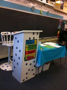 Painted podium and teacher's chair. I would want the podium to be open and lower