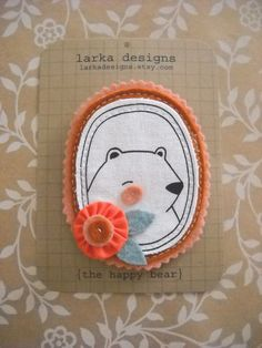 the happy bear brooch by larka designs