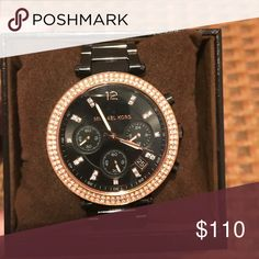 Black and rose gold Michael Kors watch In almost mint condition black Michael Kors watch with rose gold face and detailing. No scratches at all! I also have the box and warranty booklet! Michael Kors Accessories Watches