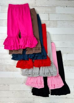Solid color tiered ruffled pants with 3 layers of ruffles. Pair with any of our tees and tops for a fun look! Toddler Boutique Clothing, Wholesale Children's Boutique Clothing, Girls Boutique, Ruffle Sleeve Dress, Ruffle Pants, Cute Girl Outfits, Cute Outfits For Kids, Cut Out Leggings, Denim Overall Dress
