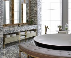 not in love with the marble but this bath is so well designed. Love the bench at the tub