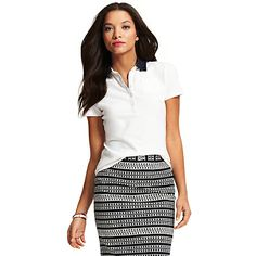 Tommy Hilfiger women's polo. Our classic polo gets a playful lift courtesy of a woven polka dot collar. Tailored with a hint of stretch for a flattering fit. <br/><ul><li>Classic fit.</li><li>94% cotton, 6% elastane.</li><li>Chest pocket, microflag at cuff.</li><li>Machine washable.</li><li>Imported.</li></ul>