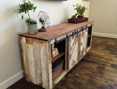 Sliding doors conceal extra storage in this doable design for a DIY console table. Perfect for a small entryway!