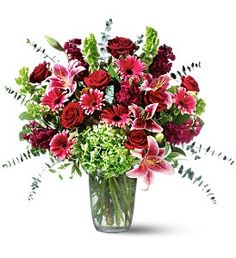 A beautiful Christmas vase arrangement of festive flowers can be great for holiday decorating.