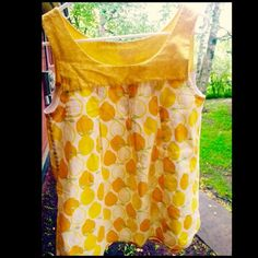 🍋Lovely lemons baby doll top🍋 Grab your girlfriends for some gelato in the park in this adorable lemon baby doll top! Perfect condition, professionally altered to a longer length, and boutique quality! Make me an offer!🌞 Andrea's B Tops